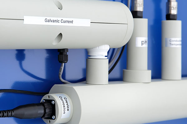 Image of plastic pipes on blue backgroundContinuous Closed System Monitoring