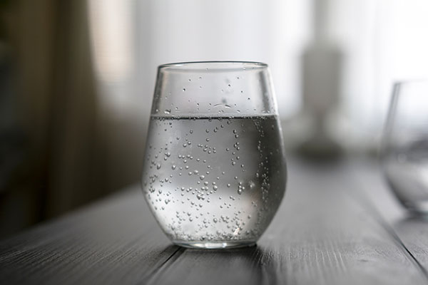Glass of fresh water with bubbles