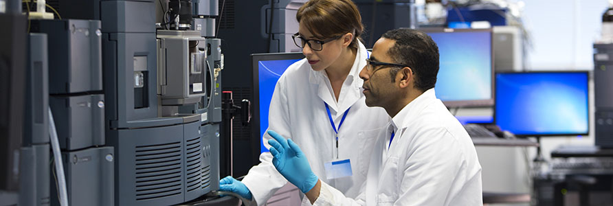 Image of two scientists in a lab taking measurements